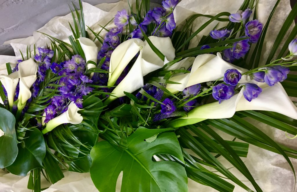 For the 4 Bridesmaids. Calla, Delphinium & Veronica with lovely tropical leaves.
